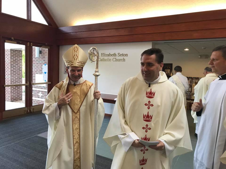 Bishop Burbidge with the newly installed Fr Bashista