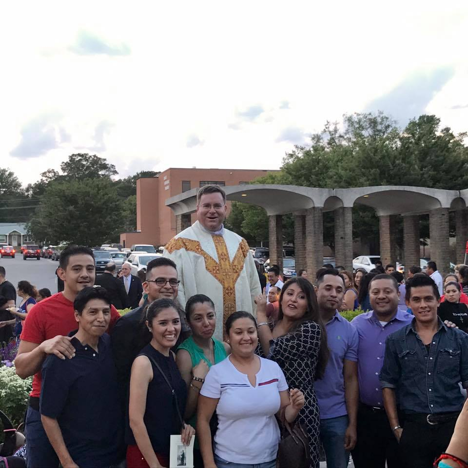 Fr Zuberbueler takes a photo with St Anthony parishioners