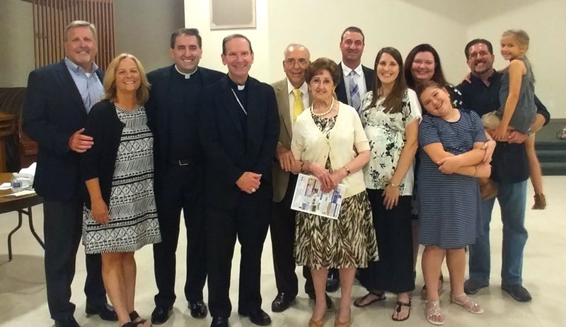 Fr. Zuberbueler with family and Bishop Burbidge